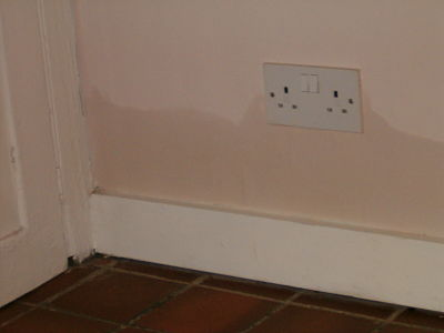 Image of rising damp affecting a plug socket.