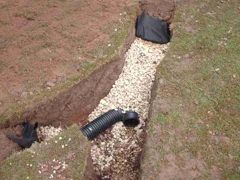 Image of a French drain under construction.