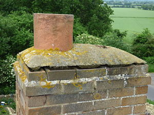 Image of lifted benching around a chimney pot.