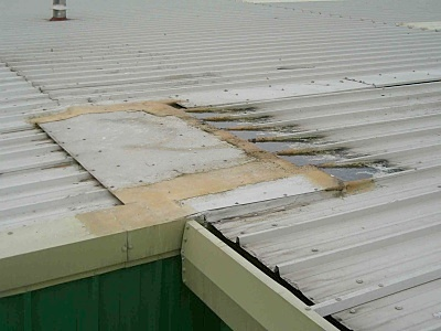 Image of a a poorly patched roof.