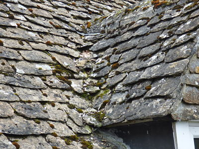 Image of a roof being re-roofed in stone slates.