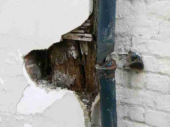Image of a rotten timber frame.