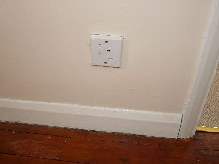 Image of a poorly fitted plug socket.